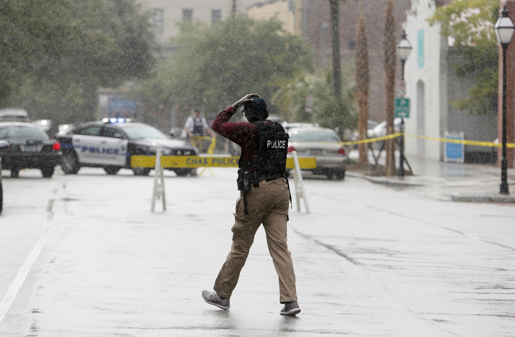 Charleston, S.C. Police Department blocks the street during an active hostage situation in Charleston, S.C., on Thursday, Aug.24, 2017.  Authorities s...