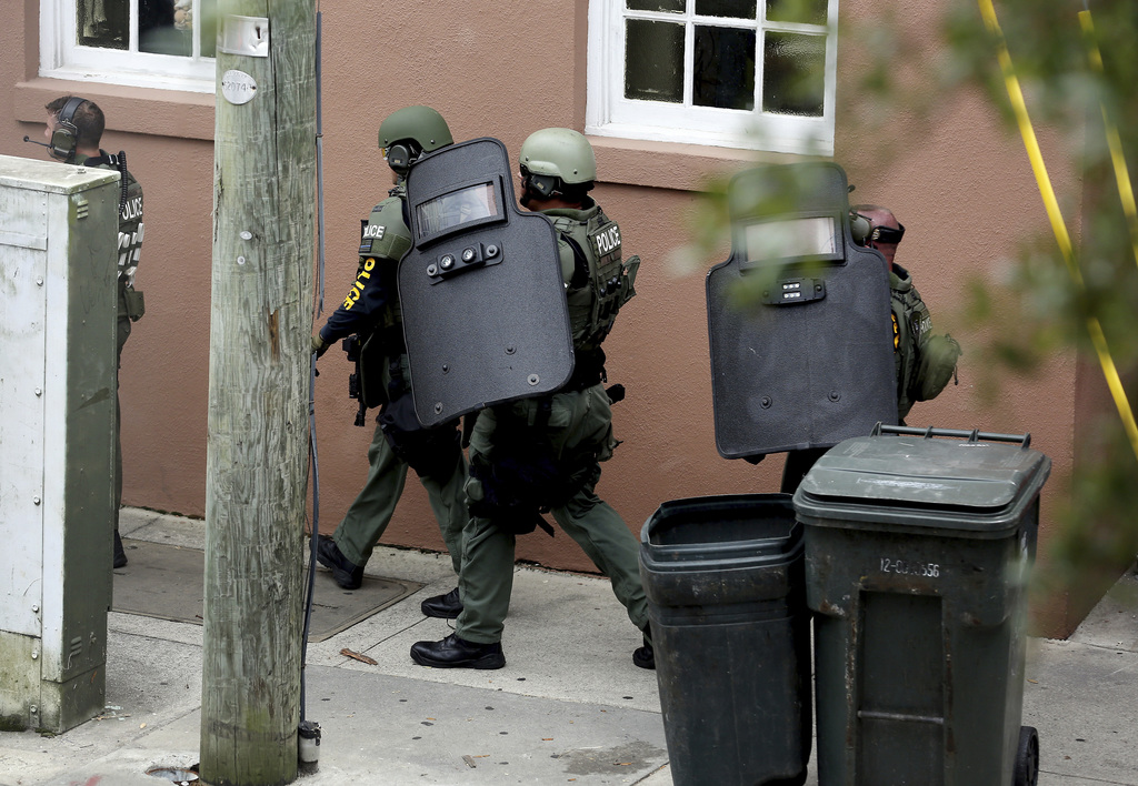 Members of the SWAT team gather on Vanderhorst Street as they respond to a shooting and hostage situation at Virginia's on King Thursday, Aug. 24, 201...