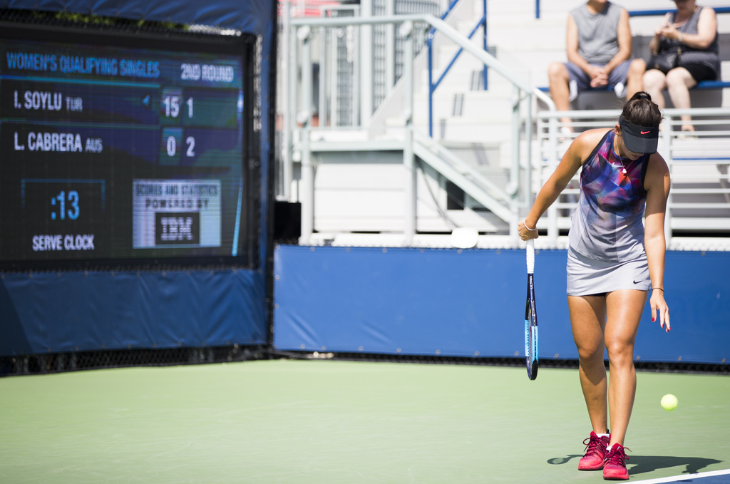 Ipek Soyluas, of Turkey, prepares to serve as the serve clock ticks down Thursday, Aug. 24, 2017, during U.S. Open tennis qualifying in New York. The ...