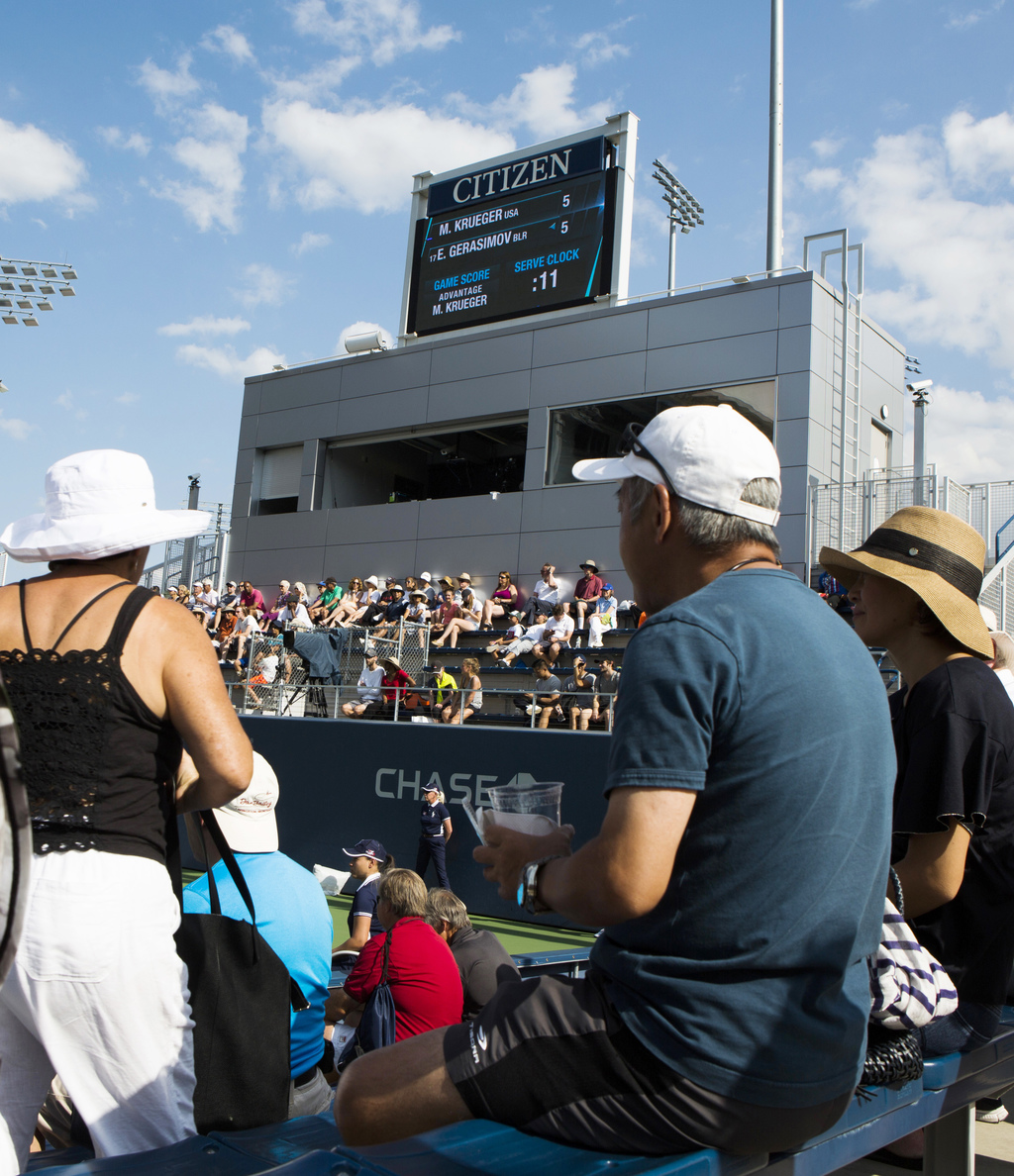 Crowds watch as Egor Gerasimov prepares to serve against Krueger Mitchell in a qualifying match Thursday, Aug. 24, 2017, at the U.S. Open tennis tourn...