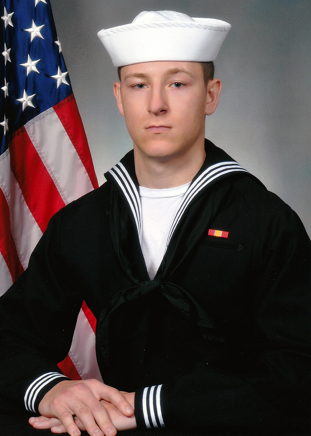 In this undated photo released by the U.S. Navy shows Electronics Technician 3rd Class Kenneth Aaron Smith from Cherry Hill, N.J. Smith, 22, was stati...