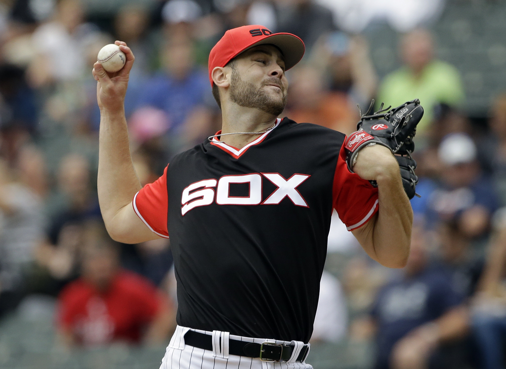 Chicago White Sox starting pitcher Lucas Giolito throws against the Detroit Tigers during the first inning of a baseball game Sunday, Aug. 27, 2017, i...