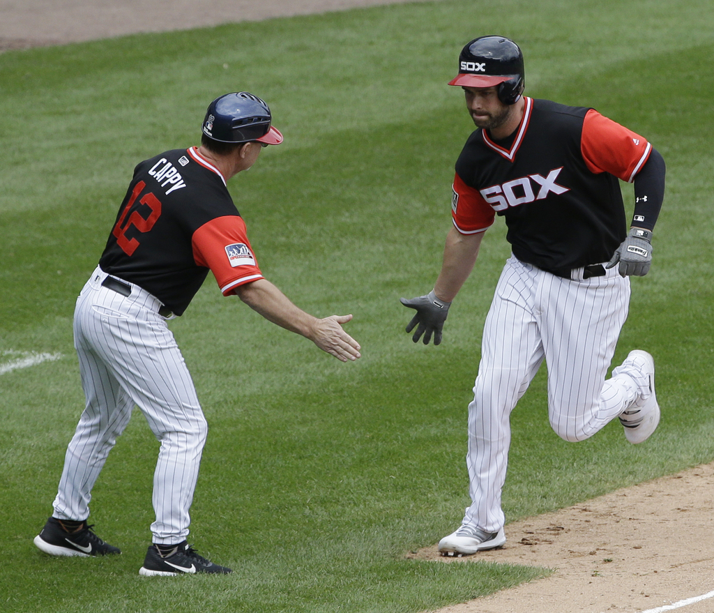Chicago White Sox's Matt Davidson, right, celebrates with third base coach Nick Capra after hitting a three-run home run during the third inning of a ...
