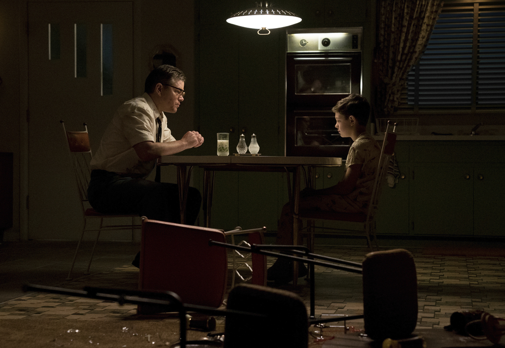 """This image released by Paramount Pictures shows Matt Damon, left, and Noah Jupe in a scene from """"Suburbicon."""" ( Hilary Bronwyn Gayle/Paramount Picture..."""