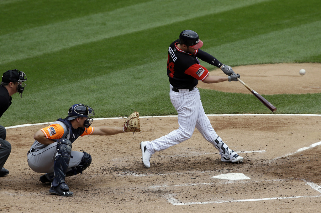 Chicago White Sox's Matt Davidson, right, hits a three-run home run during the third inning of a baseball game against the Detroit Tigers, Sunday, Aug...