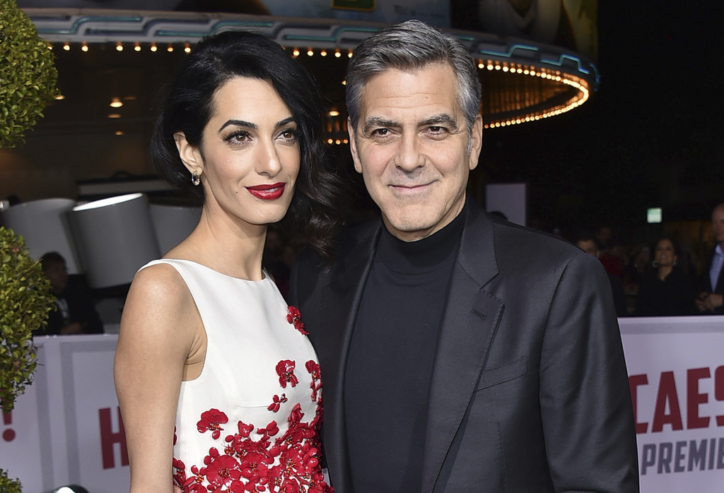 """FILE - In this Feb. 1, 2016 file photo, Amal Clooney, left, and George Clooney arrive at the world premiere of """"Hail, Caesar!"""" in Los Angeles.  Cloone..."""