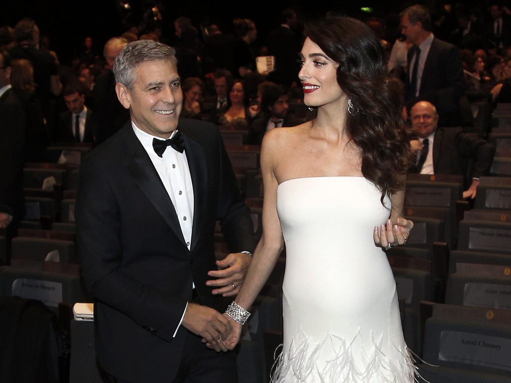 FILE - In this Feb. 24, 2017 file photo, actor George Clooney, left, and Amal Clooney arrive at the 42nd Cesar Film Awards ceremony at Salle Pleyel in...