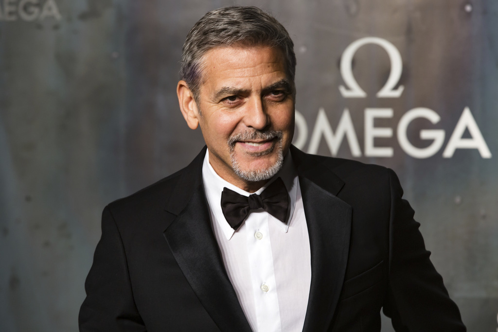 FILE - In this April 26, 2017 file photo, actor-director George Clooney arrives at the 60th anniversary of the Omega Speedster watch in London. Cloone...