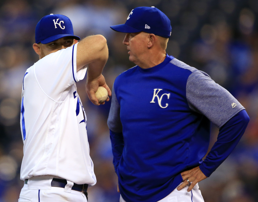 Kansas City Royals starting pitcher Ian Kennedy, left, talks with pitching coach Dave Eiland, right, after giving up a three-run home run during the t...