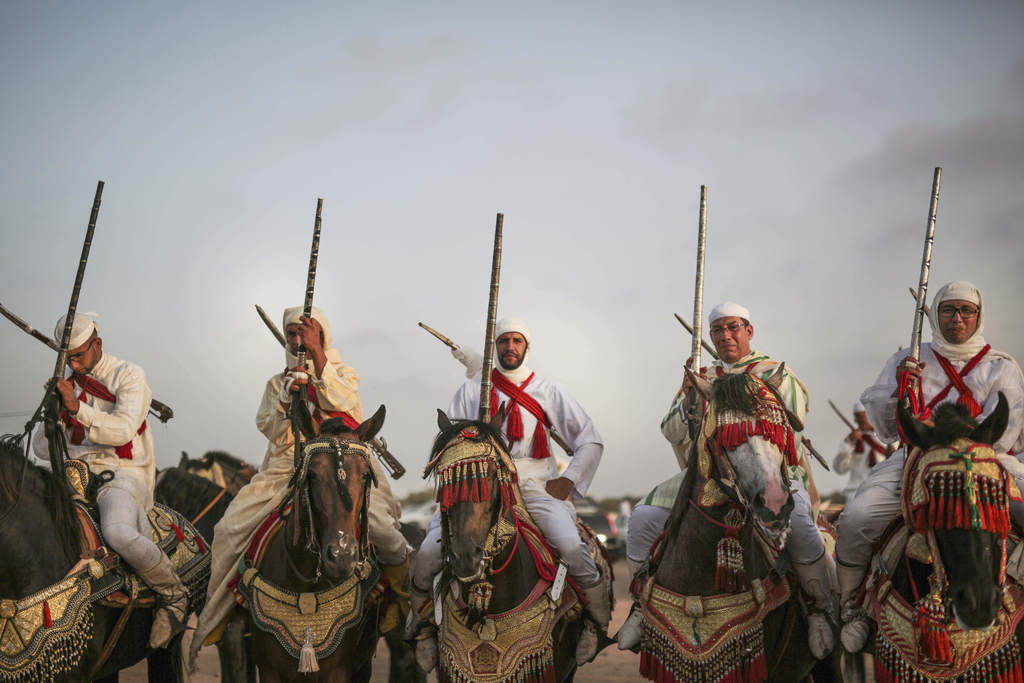 In this Thursday, Aug. 17, 2017 photo, horsemen prepare to take part in Tabourida, a traditional horse riding show also known as Fantasia, in Mansouri...