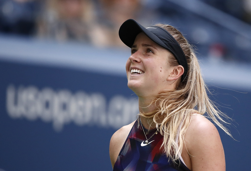 Elina Svitolina, of Ukraine, reacts after scoring a point against Evgeniya Rodina, of Russia, during the second round of the U.S. Open tennis tourname...