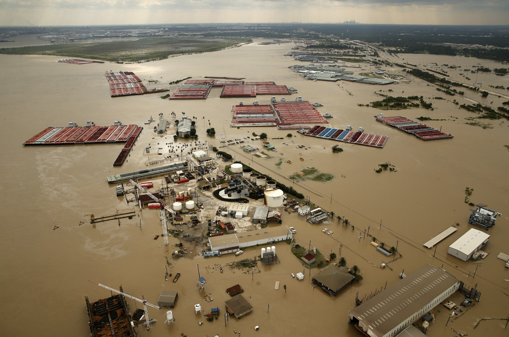 In this Aug. 30, 2017, photo, barges are secured by tugboats in the flood-swollen Burnet Bay along the Houston Ship Channel in Houston. (Tom Fox/The D...