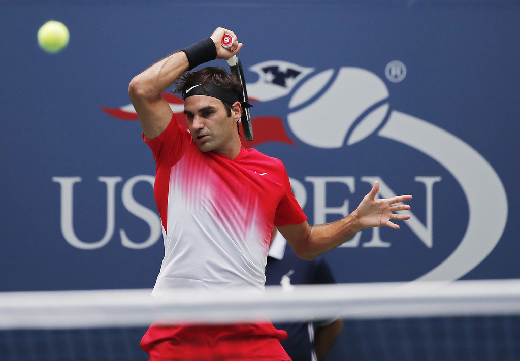 Roger Federer, of Switzerland, returns a shot from Mikhail Youzhny, of Russia, during the second round of the U.S. Open tennis tournament, Thursday, A...