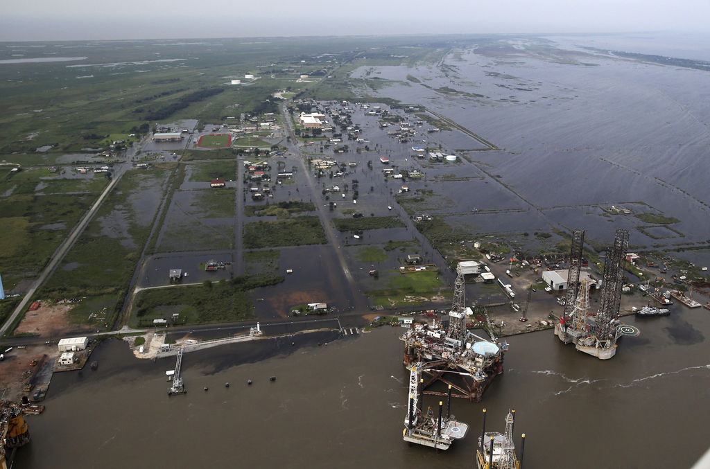 Flooding from Tropical Storm Harvey surrounds buildings in Sabine Pass, Texas, next to the Gulf of Mexico, Thursday, Aug. 31, 2017. (AP Photo/Gerald H...