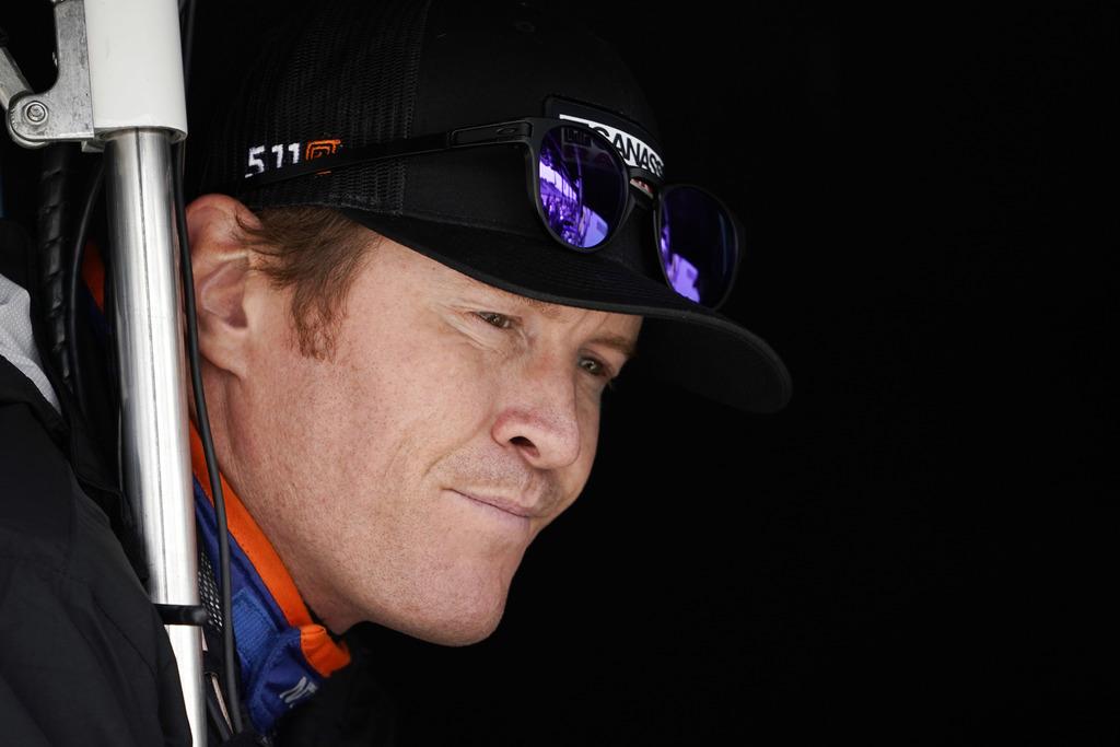 Scott Dixon waits for a practice session for Sunday's IndyCar Series auto race, Friday, Sept. 1, 2017, in Watkins Glen, N.Y. (AP Photo/Matt Slocum)