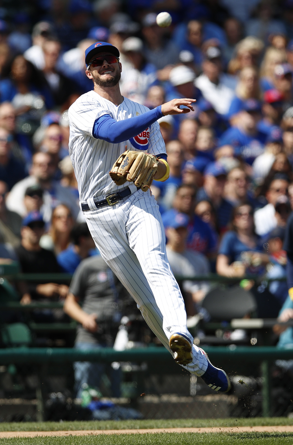Chicago Cubs third baseman Kris Bryant (17) makes a throw to first base for an out on a ball hit by Atlanta Braves catcher Kurt Suzuki during the seco...
