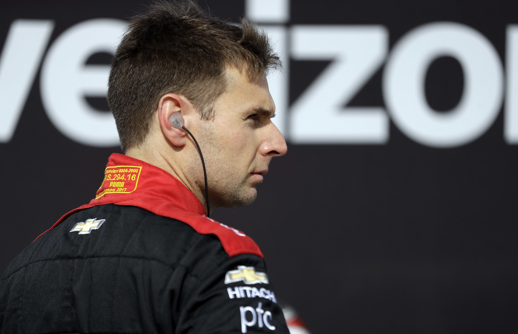 Will Power waits in his pit box before practice for Sunday's IndyCar Series auto race, Friday, Sept. 1, 2017, in Watkins Glen, N.Y. (AP Photo/Matt Slo...