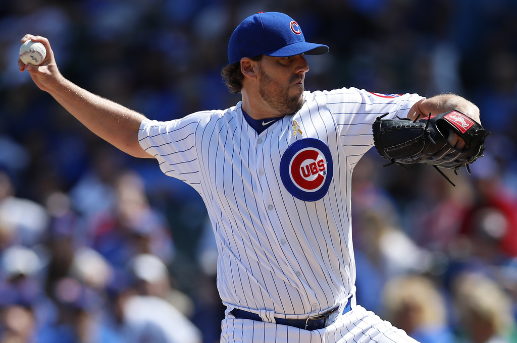 Chicago Cubs' John Lackey (41) pitches to the Atlanta Braves during the first inning of a baseball game Friday, Sept. 1, 2017, in Chicago. (AP Photo/J...