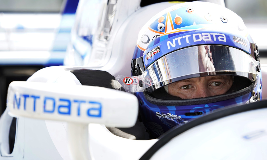 Scott Dixon sits in his car before a practice session for Sunday's IndyCar Series auto race, Friday, Sept. 1, 2017, in Watkins Glen, N.Y. (AP Photo/Ma...