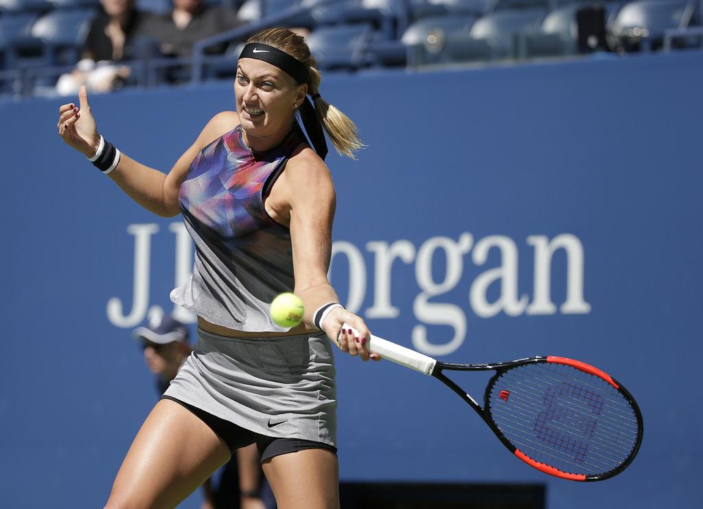 Petra Kvitova, of the Czech Republic, returns a shot from Caroline Garcia, of France, during the third round of the U.S. Open tennis tournament, Frida...