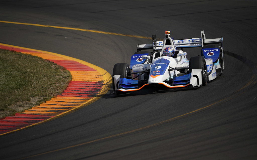 Scott Dixon drives through a turn during a practice session for Sunday's IndyCar Series auto race, Friday, Sept. 1, 2017, in Watkins Glen, N.Y. (AP Ph...