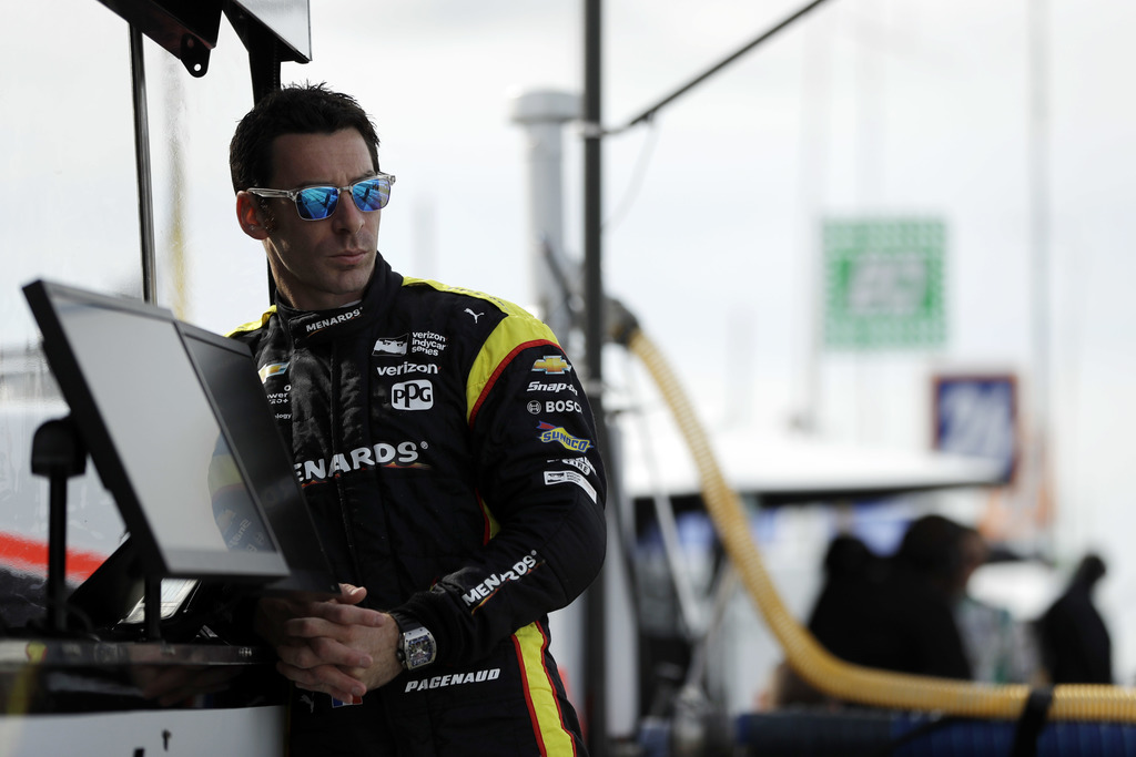 Simon Pagenaud stands in his pit box before a practice session for Sunday's IndyCar Series auto race, Friday, Sept. 1, 2017, in Watkins Glen, N.Y. (AP...