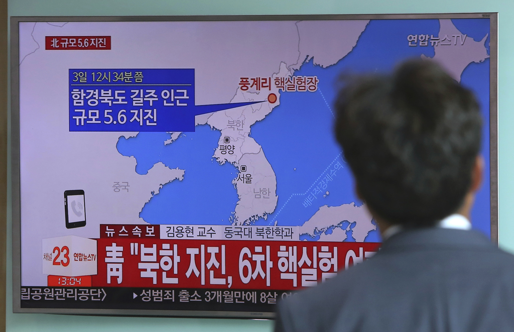 A man watches a TV news report about a possible nuclear test conducted by North Korea at the Seoul Railway station in Seoul, South Korea, Sunday, Sept...