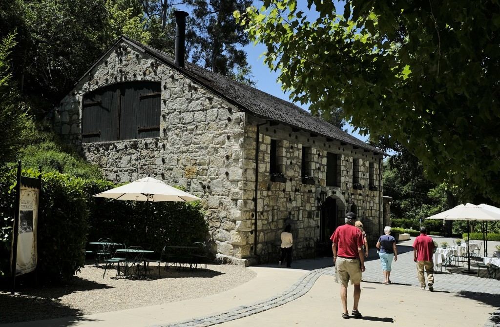 In this photo taken Monday, July 10, 2017, people make their way to the historic tasting room at the Buena Vista Winery in Sonoma, Calif. The Buena Vi...
