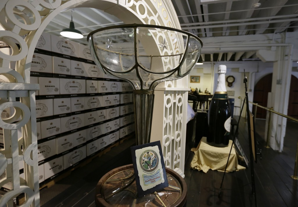 In this photo taken Monday, July 10, 2017, a super-sized glass and bottle are displayed at Korbel Champagne Cellars in Guerneville, Calif. Inside the ...