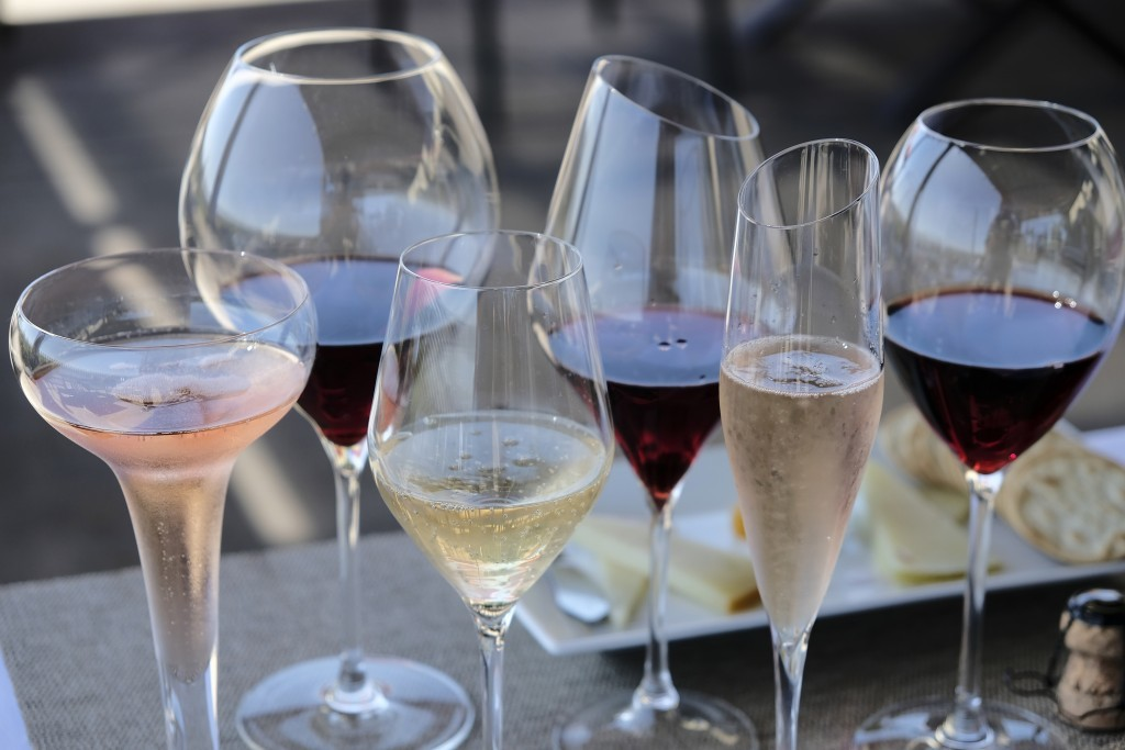 In this photo taken Monday, July 10, 2017, different shaped glasses of wine are displayed on the terrace at Gloria Ferrer Caves & Vineyards in Sonoma,...