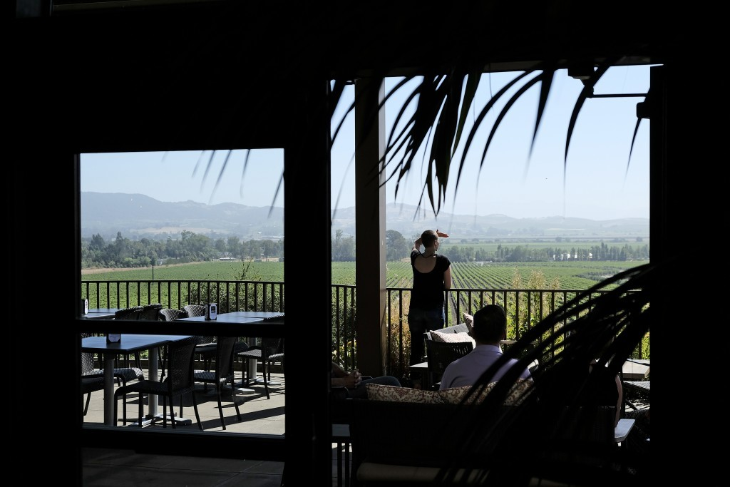 In this photo taken Monday, July 10, 2017, a woman looks out at the view from the terrace at Gloria Ferrer Caves & Vineyards in Sonoma, Calif. The Fer...