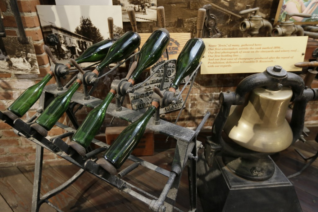 In this photo taken Monday, July 10, 2017, historic winemaking tools are displayed in a museum at Korbel Champagne Cellars in Guerneville, Calif. Insi...