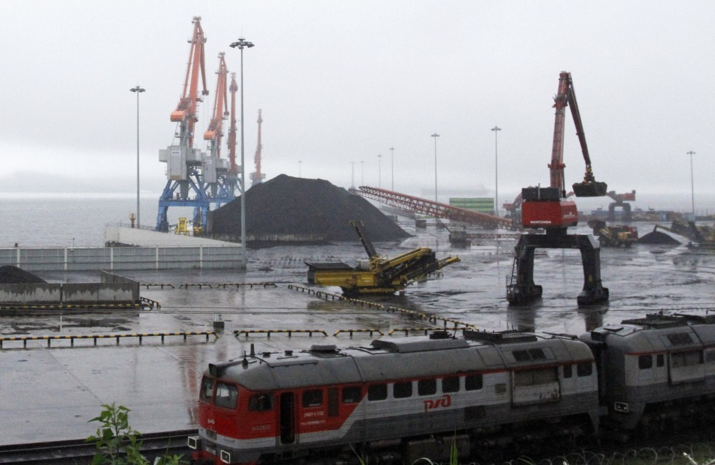 FILE - In this July 24, 2016, file photo, coal brought from Siberia is seen awaiting loading onto a ship bound for China in the North Korean special e...