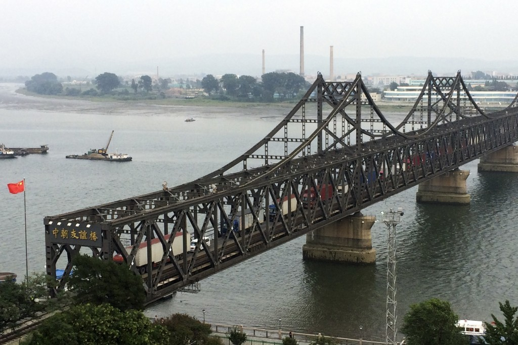 FILE - In this Monday, Sept. 4, 2017, file photo, trucks crosses the friendship bridge connecting China and North Korea in the Chinese border town of ...