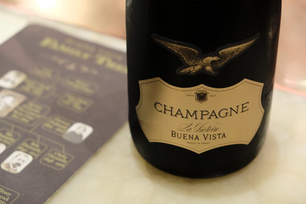 In this photo taken Monday, July 10, 2017, a bottle of La Victoire Brut Champagne, imported from France, is displayed in the bubble lounge at the Buen...