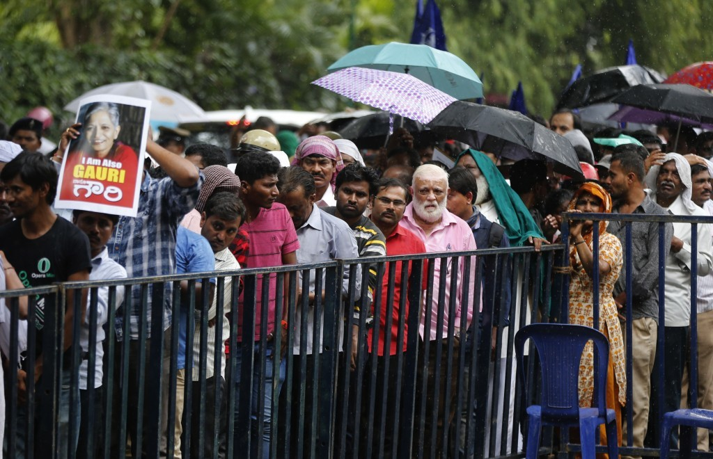 People line up to pay their respects to Indian journalist Gauri Lankesh after her body was placed for public viewing in Bangalore, India, Wednesday, S...