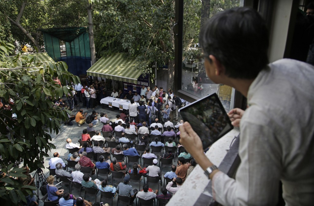 An unidentified journalist takes photographs with her iPad of a protest meeting against the killing of Indian journalist Gauri Lankesh by journalists ...