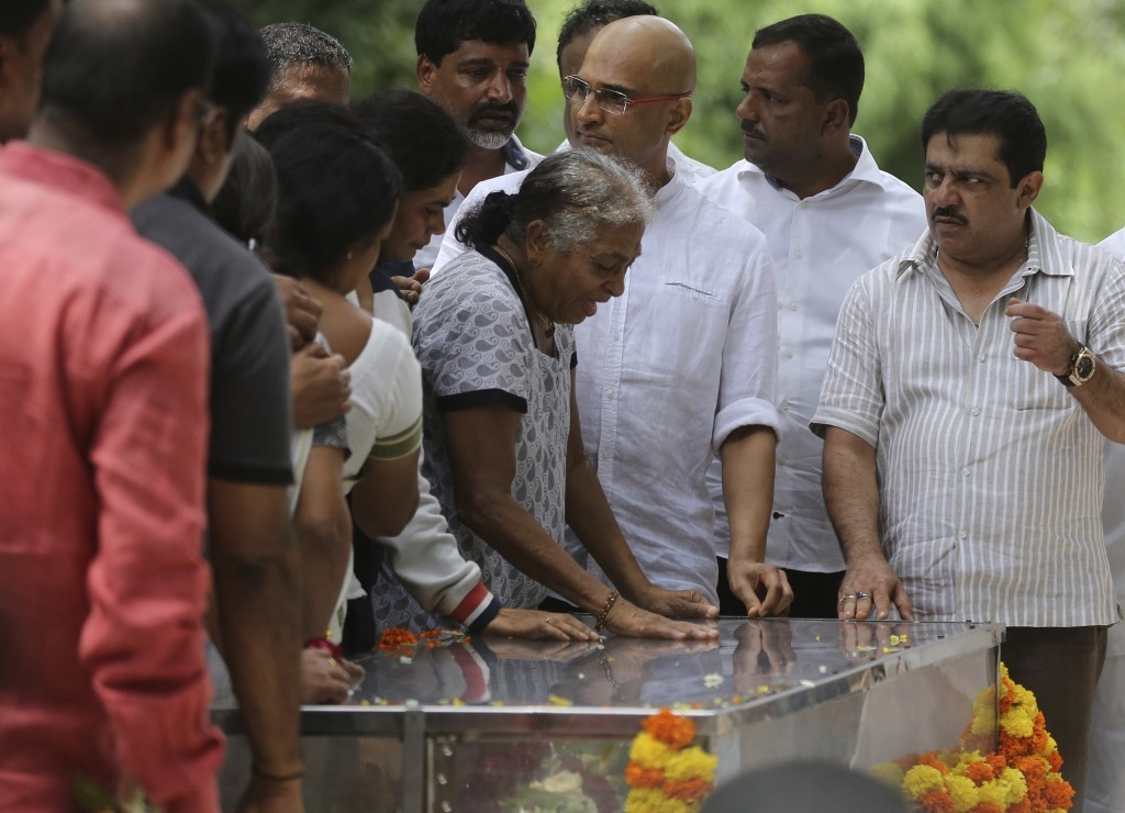 Indra Lankesh, center, mother of Indian journalist Gauri Lankesh breaks down on seeing the body of her daughter placed in a casket for public viewing ...