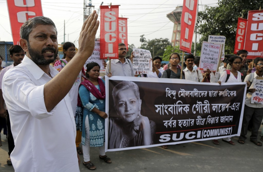 Activists of Socialist Unity Center of India- Communist (SUCI-C) march with a banner showing a portrait of Indian journalist Gauri Lankesh at a protes...