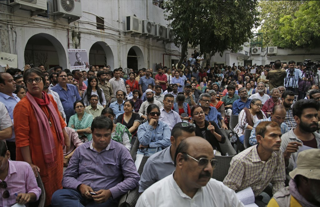 Journalists and others attend a protest meeting against the killing of Indian journalist Gauri Lankesh at Press Club of India in New Delhi, India, Wed...