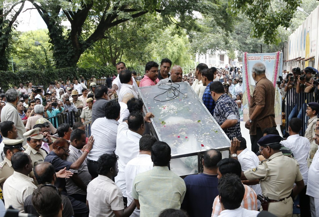 Mourners and others place the casket of Indian journalist Gauri Lankesh for public viewing in Bangalore, India, Wednesday, Sept. 6, 2017. The Indian j...