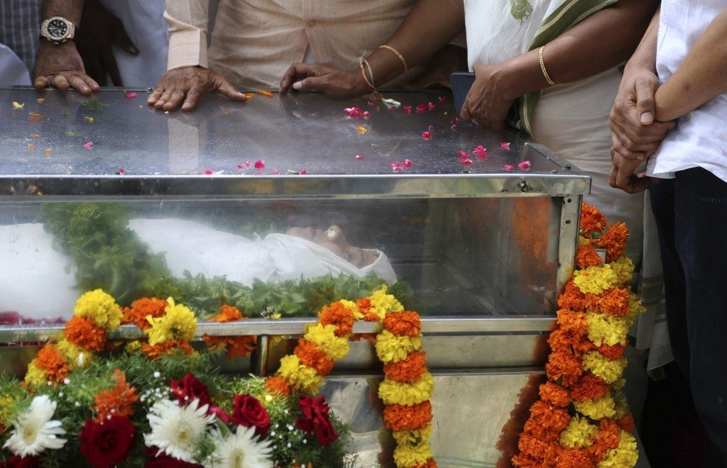 Mourners stand next to the casket of Indian journalist Gauri Lankesh placed for public viewing in Bangalore, India, Wednesday, Sept. 6, 2017. The Indi...