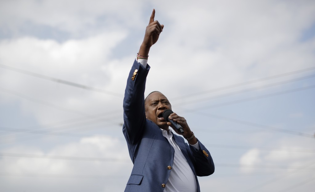 FILE - In this Tuesday, Sept. 5, 2017 file photo, Kenya's President Uhuru Kenyatta gestures as he addresses his supporters on a street in Ongata Ronga...