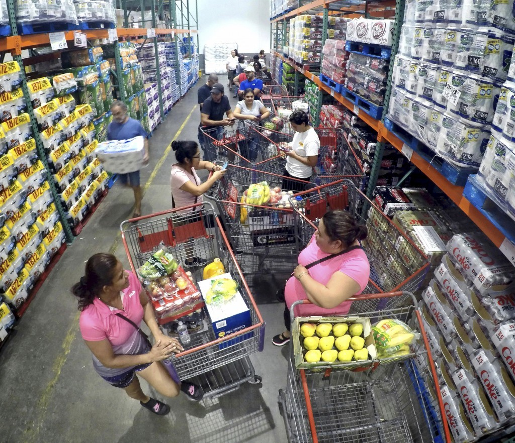 Shoppers wait in line for the arrival of a shipment of water during preparations for the impending arrival of Hurricane Irma, Wednesday, Sept. 6, 2017...