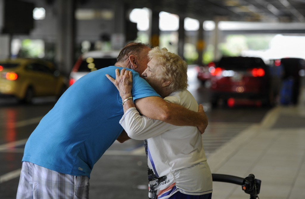 Rick Surette, left, who lives in Charlotte County, hugs his mother-in-law Jacqulyn Umhoefer, 92, from Cape Coral, Fla., after Rick drove four hours to...