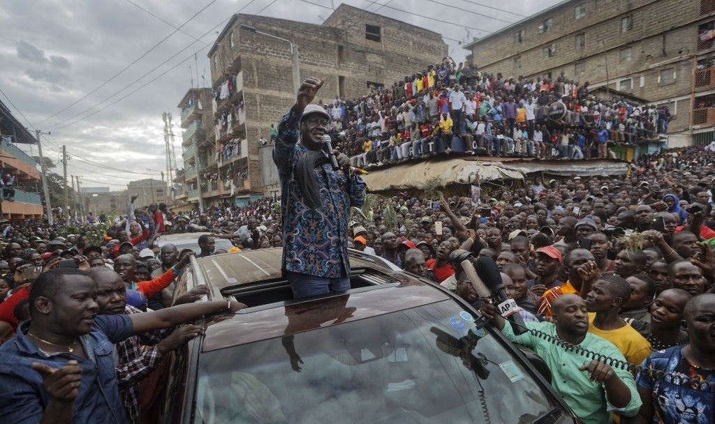 FILE - In this Sunday, Aug. 13, 2017 file photo, Kenyan opposition leader Raila Odinga gestures to thousands of supporters gathered in the Mathare are...