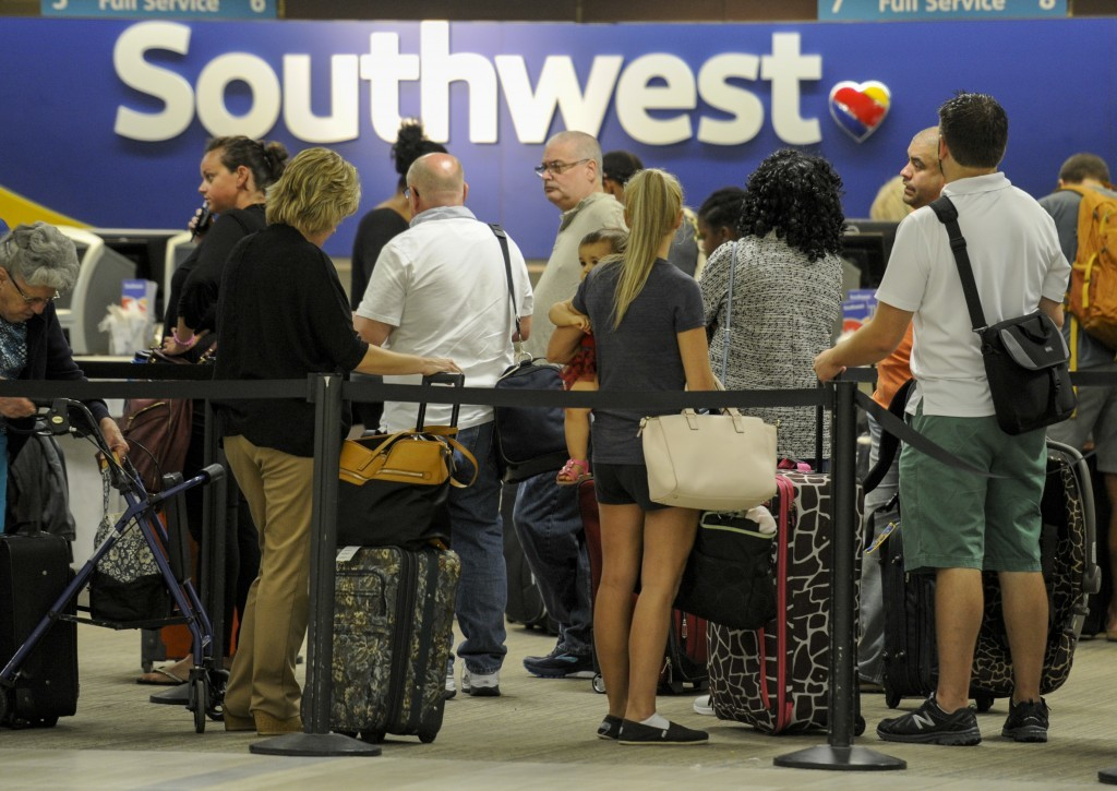 Passengers wait in line at the Southwest Airlines ticket counter Wednesday, Sept.  6, 2017 at Tampa International Airport. Many passengers were leavin...