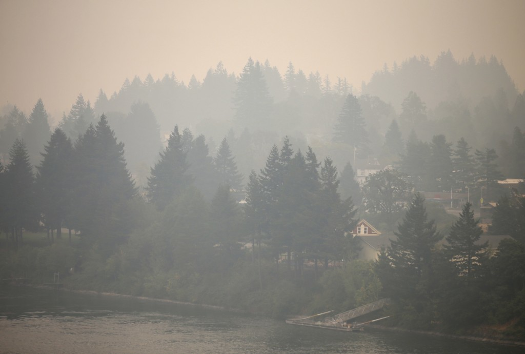 Cascade Locks, Ore., nestled in tall fir trees alongside the Columbia River, is inundated by smoke from the nearby Eagle Creek wildfire Wednesday, Sep...