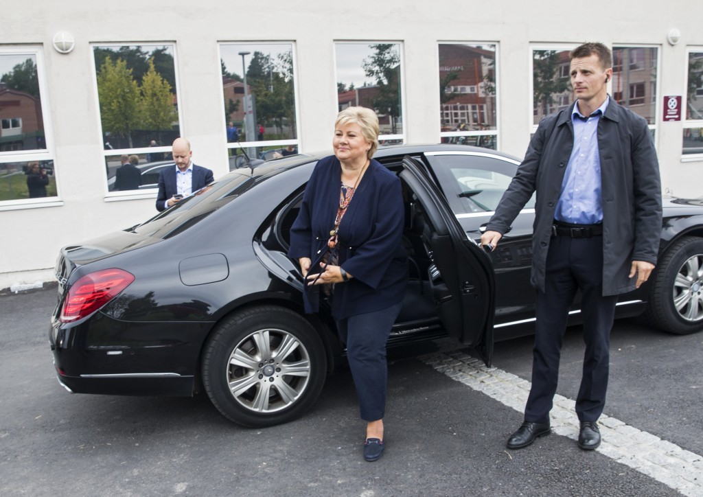 Norway's Prime Minister and leader of the Conservative Party, Erna Solberg, arrive to an event at Manglerud primary school in Oslo, Friday, Sept. 8, 2...