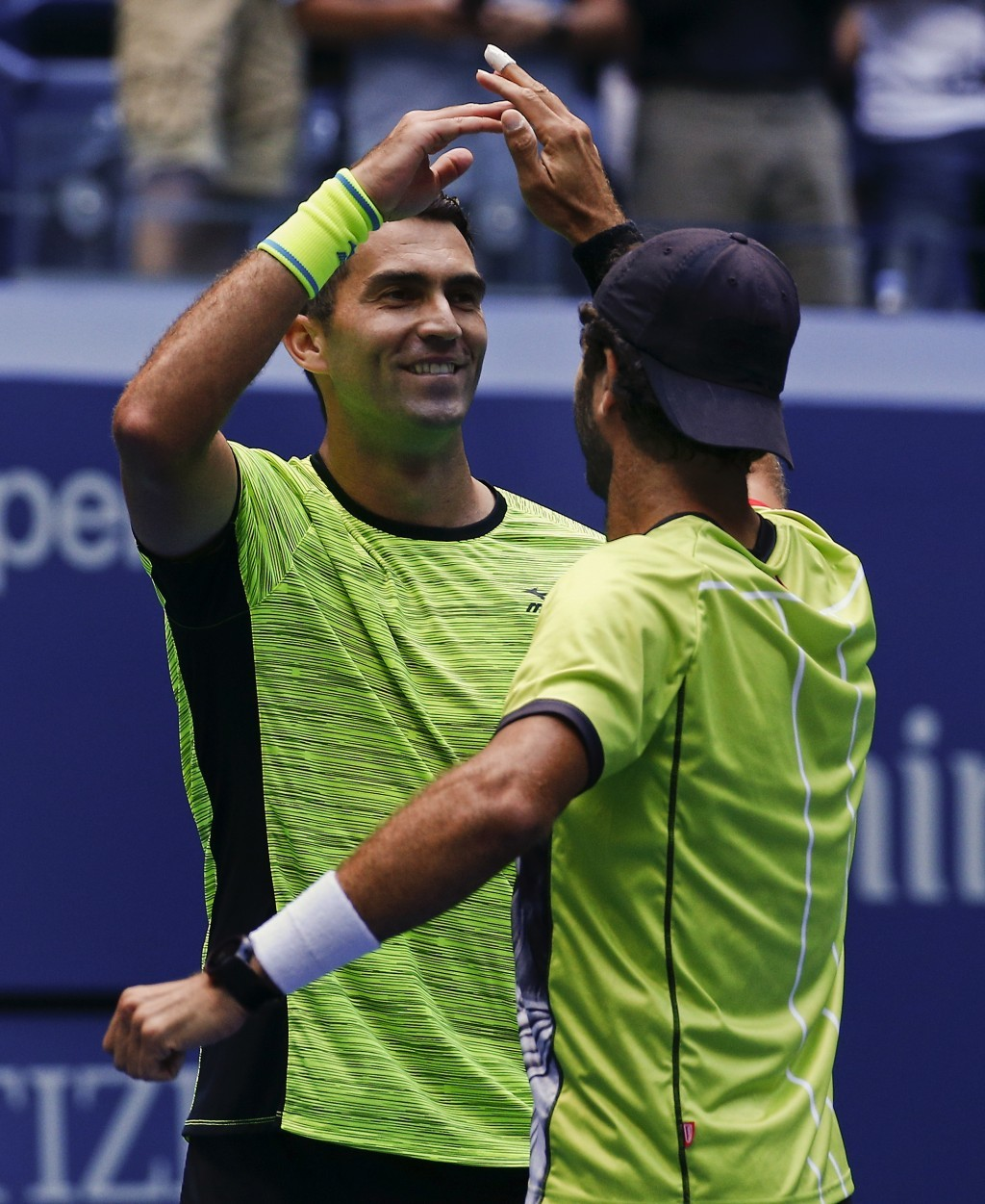 Horia Tecau, of Romania, left, and Jean-Julien Rojer, of Holland, celebrate after beating Feliciano Lopez, of Spain, and Marc Lopez in the doubles fin...